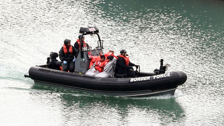 Migrants are brought to shore by Border Force officers at the Port of Dover in Kent