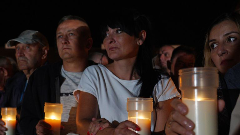 Residents of the town of Wielun hold candles as they attend ceremonies marking the 80th anniversary of the outbreak of the World War II, in Wielun on September 1, 2019. - German President Frank-Walter Steinmeier on September 1, 2019 asked Poland's forgiveness for history's bloodiest conflict during a ceremony in the Polish city of Wielun, where the first World War II bombs fell 80 years ago. (Photo by Alik KEPLICZ / AFP)        (Photo credit should read ALIK KEPLICZ/AFP/Getty Images)