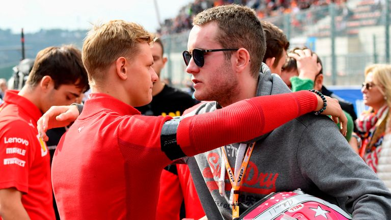 Prema Racing's German driver Mick Schumacher (L) present his condolences to the brother of the French driver Anthoine Hubert before the start of the race of Formula3 on September 1, 2019, at the Spa-Francorchamps circuit in Spa the day of the Belgian Formula One Grand Prix - French driver Anthoine Hubert, 22, was killed on August 31 in Spa in an accident during a Formula 2 race held on the sidelines of the F1 Grand Prix, according to organizers of the race. (Photo by JOHN THYS / AFP)        (Photo credit should read JOHN THYS/AFP/Getty Images)