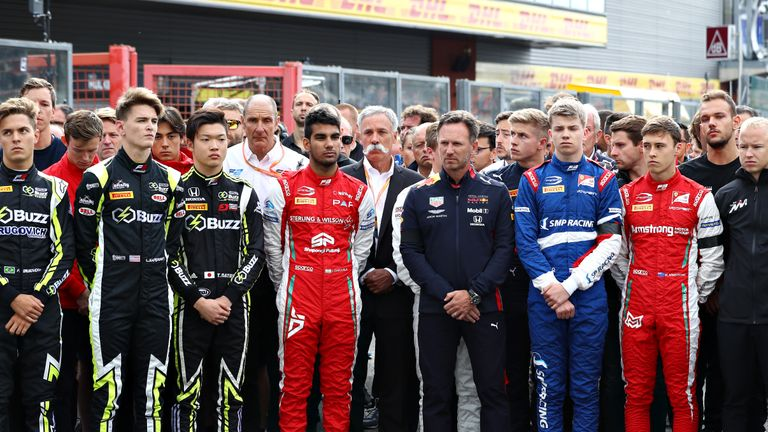 SPA, BELGIUM - SEPTEMBER 01: Red Bull Racing Team Principal Christian Horner, Chase Carey, CEO and Executive Chairman of the Formula One Group, and the Formula 2 and Formula 3 community stand for a minutes silence in tribute to the late Formula 2 driver Anthoine Hubert on the Formula 3 grid before the F1 Grand Prix of Belgium at Circuit de Spa-Francorchamps on September 01, 2019 in Spa, Belgium. (Photo by Mark Thompson/Getty Images)