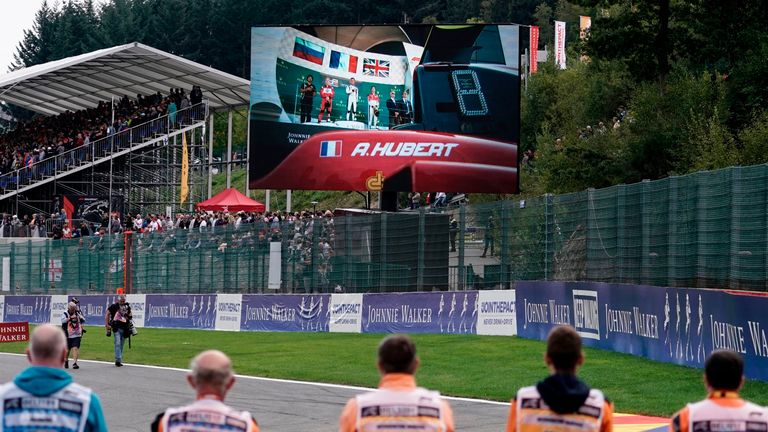 A picture of late BWT Arden's French driver Anthoine Hubert, who died in an accident during a Formula 2 race on August 31, is displayed on a giant screen as drivers, team members and track marshals observe a minute's silence for Hubert before the start of the Belgian Formula One Grand Prix at the Spa-Francorchamps circuit in Spa on September 1, 2019. (Photo by Kenzo TRIBOUILLARD / AFP)        (Photo credit should read KENZO TRIBOUILLARD/AFP/Getty Images)