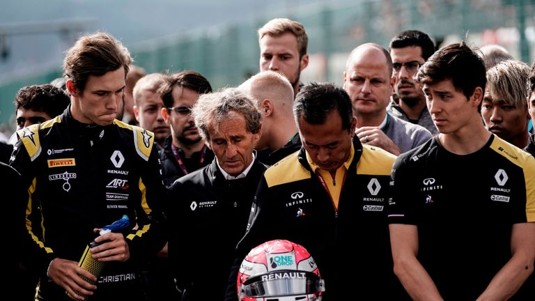 TOPSHOT - Retired French racing driver and Renault special advisor Alain Prost (2L) and Renault team members observe a minute's silence before the start of the race of Formula3 on September 1, 2019, at the Spa-Francorchamps circuit in Spa the day of the Belgian Formula One Grand Prix. - French driver Anthoine Hubert, 22, was killed on August 31 in Spa in an accident during a Formula 2 race held on the sidelines of the F1 Grand Prix, according to organizers of the race. (Photo by Kenzo TRIBOUILLARD / AFP)        (Photo credit should read KENZO TRIBOUILLARD/AFP/Getty Images)