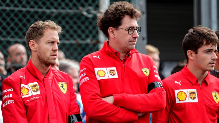 Ferrari's German driver Sebastian Vettel (L), Ferrari's team chief Mattia Binotto (C) and Ferrari's Monegasque driver Charles Leclerc observe a minute of silence before the start of the race of Formula3 on September 1, 2019, at the Spa-Francorchamps circuit in Spa the day of the Belgian Formula One Grand Prix. - French driver Anthoine Hubert, 22, was killed on August 31 in Spa in an accident during a Formula 2 race held on the sidelines of the F1 Grand Prix, according to organizers of the race. (Photo by Kenzo TRIBOUILLARD / AFP)        (Photo credit should read KENZO TRIBOUILLARD/AFP/Getty Images)