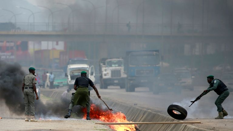 Police officers remove flaming tires after protesters blocked traffic along Airport Road in Abuja, Nigeria September 4, 2019. REUTERS/Afolabi Sotunde