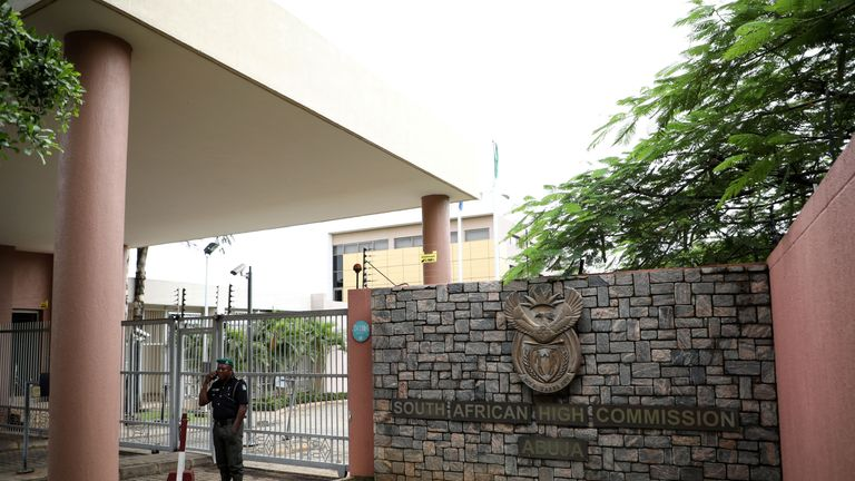 A policeman stands at the main gate of the South African High Commission after it was shut down to avert reprisal attacks in Abuja, on September 5, 2019. - South Africa said on September 5, 2019 it had temporarily closed its diplomatic missions in Nigeria following violence against South African businesses carried out in reprisal for attacks on foreign-owned stores in Johannesburg. (Photo by KOLA SULAIMON / AFP)        (Photo credit should read KOLA SULAIMON/AFP/Getty Images)