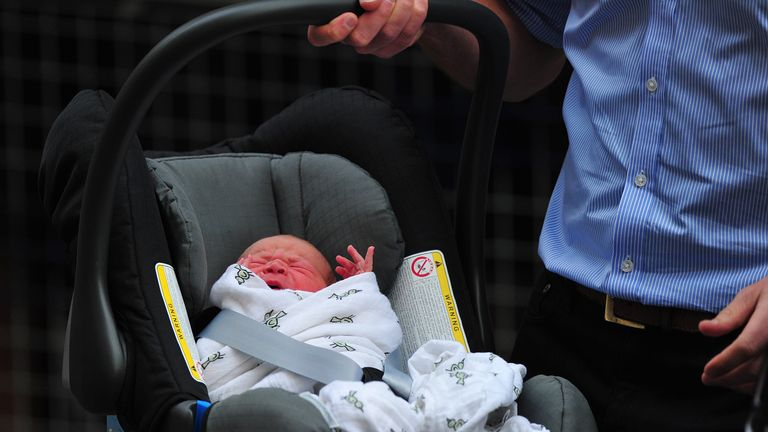 Prince William and Catherine, Duchess of Cambridge's new-born baby boy is introduced to the world's media outside the Lindo Wing of St Mary's Hospital in London on July 23, 2013. The baby was born on Monday afternoon weighing eight pounds six ounces (3.8 kilogrammes). The baby, titled His Royal Highness, Prince (name) of Cambridge, is directly in line to inherit the throne after Charles, Queen Elizabeth II's eldest son and heir, and his eldest son William.   AFP PHOTO / CARL COURT        (Photo credit should read CARL COURT/AFP/Getty Images)