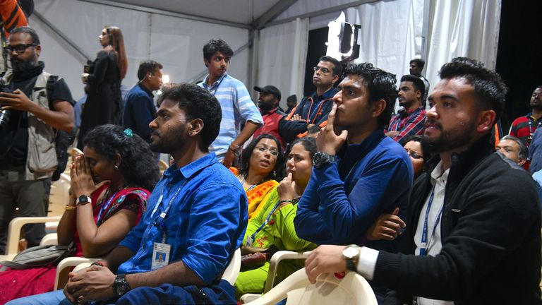 Indian Space Research Organisation (ISRO) employees react as they watch the live broadcast of the soft landing of spacecraft Vikram Lander of Chandrayaan-2 on the surface of the Moon at ISRO Telemetry, Tracking and Command Network (ISTRAC) centre in Bangalore early on September 7, 2019. - India lost communication with its unmanned spacecraft on September 7 just before it was due to land on the Moon, in a major setback to the country's lunar ambitions amid renewed interest in Earth's satellite. (Photo by Manjunath Kiran / AFP)        (Photo credit should read MANJUNATH KIRAN/AFP/Getty Images)