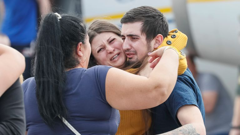 A recently exchanged Ukrainian prisoner is greeted by his relatives upon arrival in Kiev after Russia-Ukraine prisoner swap, at Borispil International Airport, outside Kiev, Ukraine September 7, 2019. REUTERS/Gleb Garanich