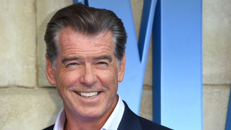 """Pierce Brosnan poses on the red carpet upon arrival for the world premiere of the film """"Mamma Mia! Here We Go Again"""" in London on July 16, 2018. (Photo by Anthony HARVEY / AFP)        (Photo credit should read ANTHONY HARVEY/AFP/Getty Images)"""