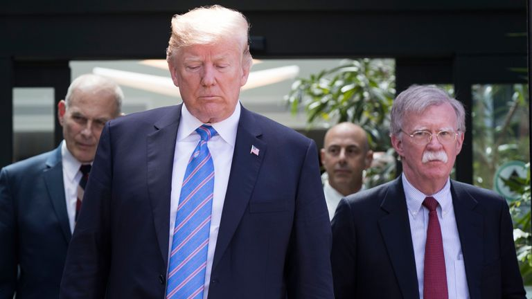 US President Donald Trump, with National Security Advisor John Bolton (R) and White House Chief of Staff John Kelly (L), leaves the G7 summit in La Malbaie, Quebec, June 9, 2018. (Photo by Lars Hagberg / AFP)        (Photo credit should read LARS HAGBERG/AFP/Getty Images)