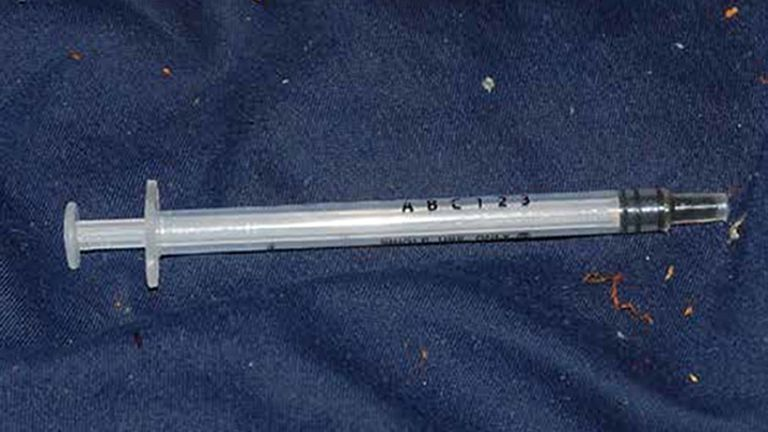 Metropolitan Police undated handout photo of a syringe found in the flat of Brandon Dunbar who targeted 12 men over a 19-month period with Gerald Matovu. Matovu was found guilty at the Old Bailey, London, for the murder of Eric Michels after he plied him with a fatal dose of GHB at his home in Bolton Road, Chessington, Surrey, then made off with his bank card details and other belongings.