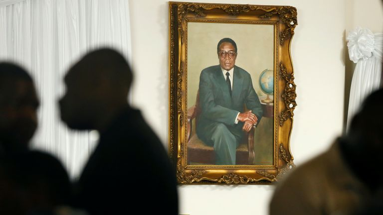 Grace Mugabe sits below a portrait of her late husband, former Zimbabwean President Robert Mugabe, at her residence, The 'Blue Roof' in Borrowdale, Harare, Zimbabwe, September 11,2019. REUTERS/Philimon Bulawayo
