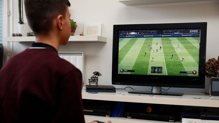 PARIS, FRANCE - DECEMBER 19: In this photo illustration a gamer plays the video game 'FIFA 19' developed and published by Electronic Arts (EA) on a Sony PlayStation game console PS4 Pro on December 19, 2018 in Paris, France. FIFA 19 is a soccer video game released on September 28, 2018. This is the twenty-sixth installment of the FIFA franchise developed by EA. (Photo Illustration by Chesnot/Getty Images)