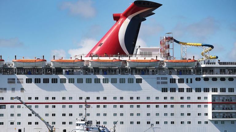 MIAMI, FLORIDA - APRIL 18: The Carnival Sensation cruise ship is seen at PortMiami on April 18, 2019 in Miami, Florida.  Reports indicate that Carnival Corporation repeatedly broke environmental laws even during its first year of being on probation after being convicted of systematically violating environmental laws. (Photo by Joe Raedle/Getty Images)