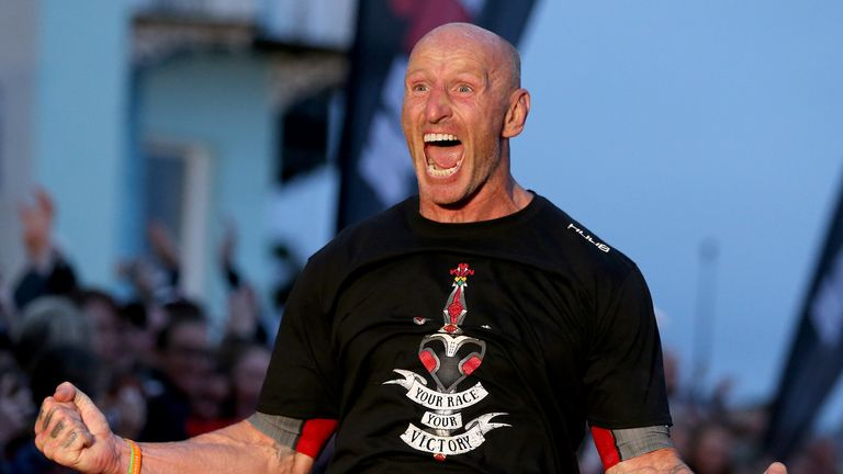 TENBY, WALES - SEPTEMBER 15:  Former Welsh rugby International captain Gareth Thomas reacts after finishing Ironman Wales on September 15, 2019 in Tenby, Wales. (Photo by Nigel Roddis/Getty Images for IRONMAN)