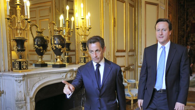 """French President Nicolas Sarkozy (L) welcomes the new Britain's Prime minister David Cameron at the Elysee Palace on May 20, 2010 in Paris. Cameron and his coalition deputy unveiled full details today of their """"historic"""" power-sharing deal, under growing scrutiny for signs of strain. AFP PHOTO / POOL / PHILIPPE WOJAZER (Photo credit should read PHILIPPE WOJAZER/AFP/Getty Images)"""