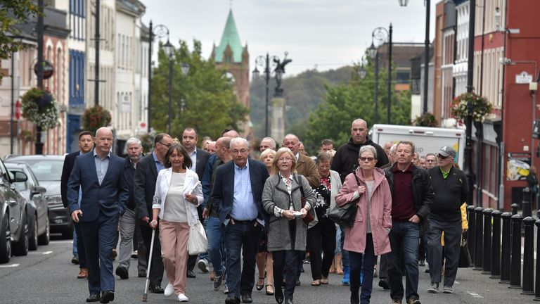 "LONDONDERRY, UNITED KINGDOM - SEPTEMBER 18: Relatives of victims in the case of ""Soldier F"" walk towards Bishop Street courthouse on September 18, 2019 in Londonderry. Northern Ireland. Relatives of people killed and injured walked toward Londonderry court house before the start of the trial of ""Soldier F"", an Army veteran in his 60s, charged with the murders of two men killed during the 1972 ""Bloody Sunday"" incident. Thirteen people died when British paratroopers opened fire on demonstrators in Derry on January 30 of that year. ""Soldier F,"" who is unlikely to attend the trial in person, is the only paratrooper charged in connection with the deaths. (Photo by Charles McQuillan/Getty Images)"