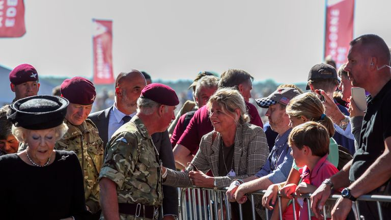 Prince Charles stops to talk with visitors at a commemorative service and wreath-laying with Princess Beatrix of The Netherlands at Ginkel Heath on Ginkel Heath near Ede . The Prince is Colonel-in-Chief of The Parachute Regiment and The Army Air Corps. 1500 paratroopers from Great Britain, USA, The Netherlands and Poland are parachuting onto the Heath as part of the Operation Market Garden 75th anniversary commemorations near Arnhem, Netherlands.