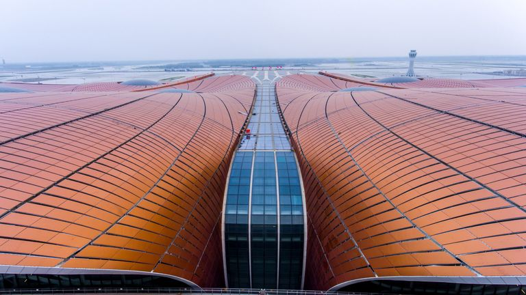 This photo taken on June 25, 2019 shows the roof of the terminal of the new Beijing Daxing International Airport. - Beijing is set to open an eye-catching multi-billion dollar airport resembling a massive shining starfish, to accommodate soaring air traffic in China and celebrate the Communist government's 70th anniversary in power. (Photo by STR / AFP) / China OUT / To go with China-Aviation, Focus by Patrick Baert        (Photo credit should read STR/AFP/Getty Images)