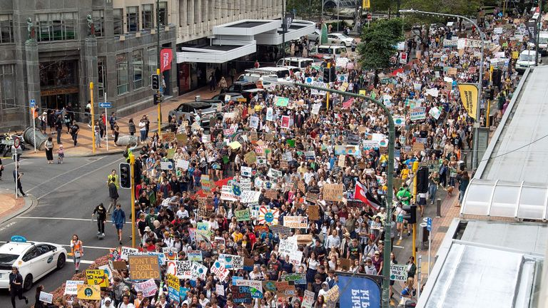 School children march up Lambton Quay to Parliament during a strike and protest by students highlighting inadequate progress to address climate change at Civic Square in Wellington on March 15, 2019. (Photo by Marty MELVILLE / AFP)        (Photo credit should read MARTY MELVILLE/AFP/Getty Images)