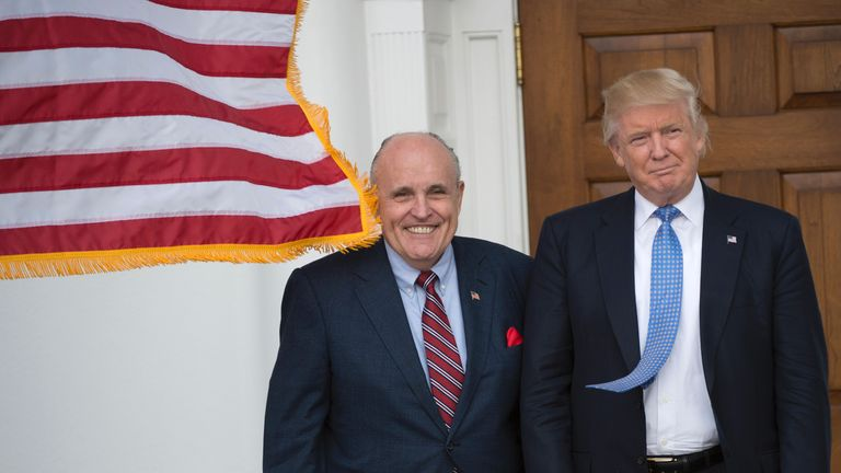 President-elect Donald Trump meets with former New York City Mayor Rudy Giuliani at the clubhouse of Trump National Golf Club November 20, 2016 in Bedminster, New Jersey. / AFP / Don EMMERT        (Photo credit should read DON EMMERT/AFP/Getty Images)