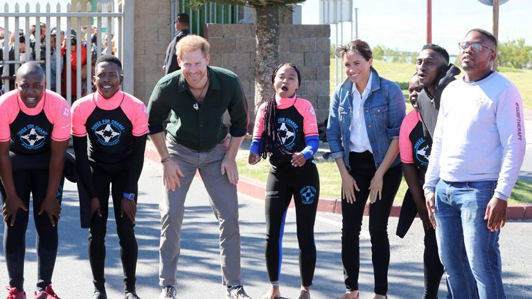 The Duke and Duchess of Sussex with surf mentors during a visit to Waves for Change at Monwabisi Beach in Cape Town, on day two of the royal tour of Africa.