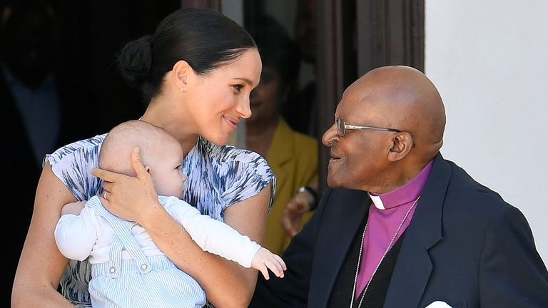 The Duchess of Sussex holding her son Archie meets with Archbishop Desmond Tutu in cape Town, on day three of their tour of Africa.