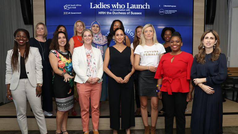 The Duchess of Sussex poses with 12 inspiring female entrepreneurs during a visit to the Woodstock Exchange in Cape Town to meet female entrepreneurs working in technology, on day three of her tour of Africa with the Duke of Sussex.