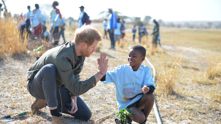 The Duke of Sussex helps local schoolchildren plant trees at the Chobe Tree Reserve in Botswana, on day four of their tour of Africa.