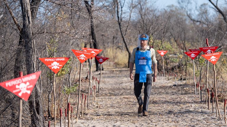 The Duke of Sussex walks through a minefield in Dirico, Angola, during a visit to see the work of landmine clearance charity the Halo Trust, on day five of the royal tour of Africa.