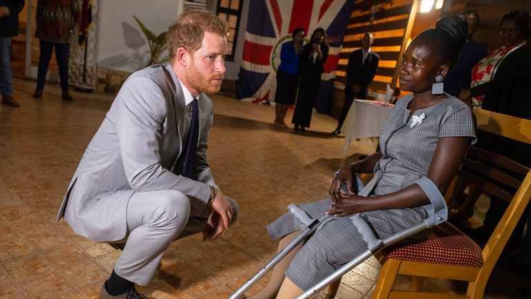 The Duke of Sussex meets landmine victim Sandra Tigica, who Princess Diana met on her visit to Angola 1997, during a reception at the British Ambassadors Residence in Luanda, Angola, on day five of the royal tour of Africa.