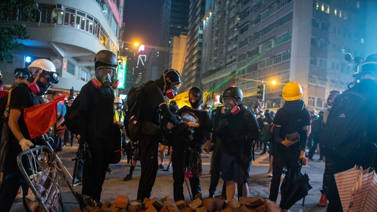 "HONG KONG - SEPTEMBER 30:  Protestors gather bricks during a rally on September 30, 2019 in Hong Kong, China. Pro-democracy demonstrations have entered its fourth month as Hong Kong braces for the 70th anniversary of the founding of the People's Republic of China with a series of pro and anti-Beijing protests scheduled towards October 1. Anti-government protesters have continued its call for Chief Executive Carrie Lam to meet their remaining demands, including an independent inquiry into police brutality, the retraction of the word ""riot"" to describe the rallies, and genuine universal suffrage. (Photo by Billy H.C. Kwok/Getty Images)"