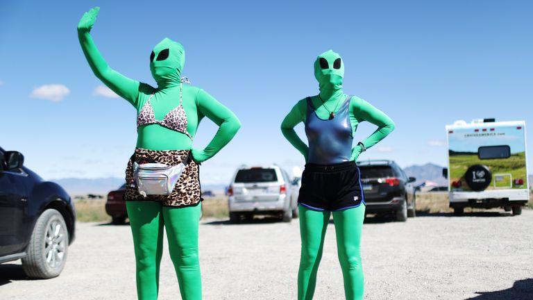 Women are dressed as aliens at a 'Storm Area 51' spinoff event called 'Alienstock' on September 20, 2019 in Rachel, Nevada