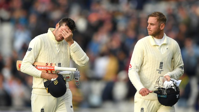 England batsman Craig Overton (l) and Stuart Broad walk off after the match is lost