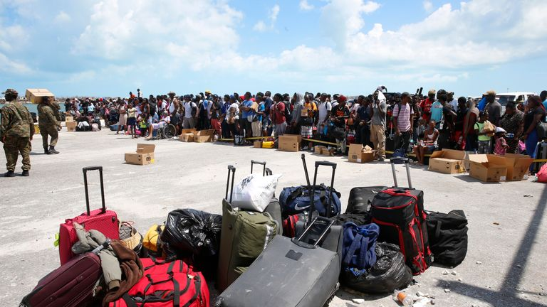 People wait to evacuated in private boats at the Marsh Harbour Port in hurricane devastated Grand Abaco Island on September 6, 2019