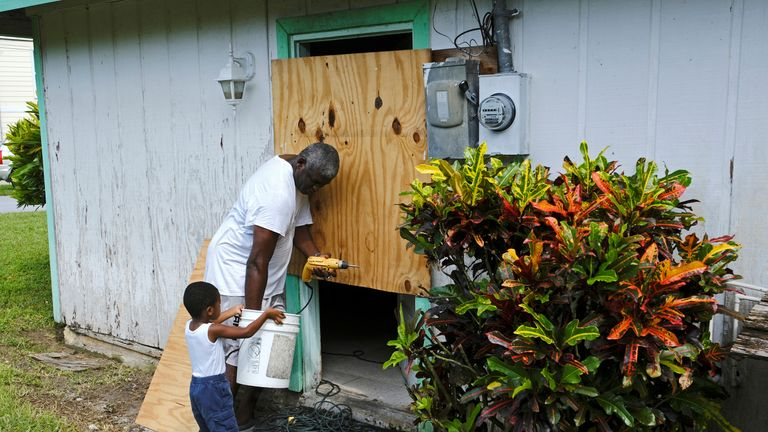 People board up a house on Great Abaco island