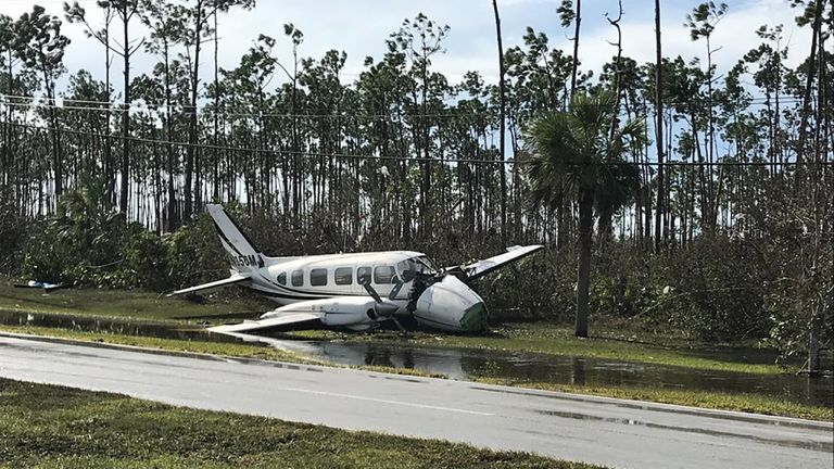 A smashed plane was part of the debris left by Hurricane Dorian at Grand Bahama International Airport