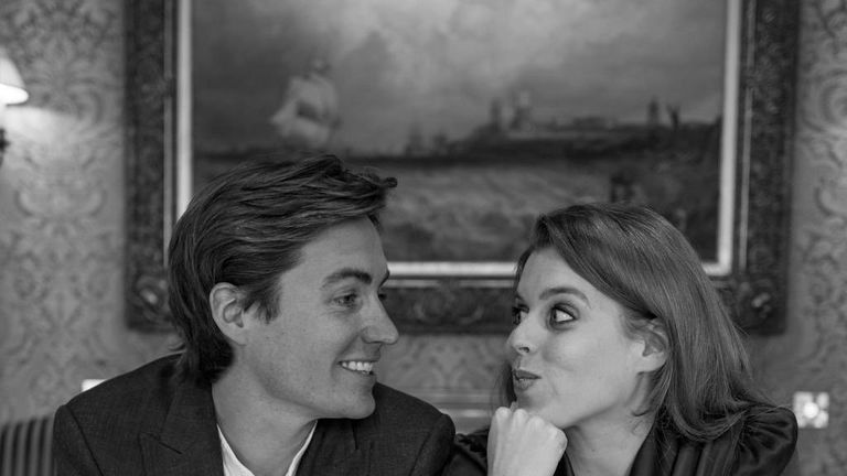 Mr Mapelli Mozzi and Princess Beatrice at smile at each other at an engagement shoot. Pic: @SarahTheDuchess