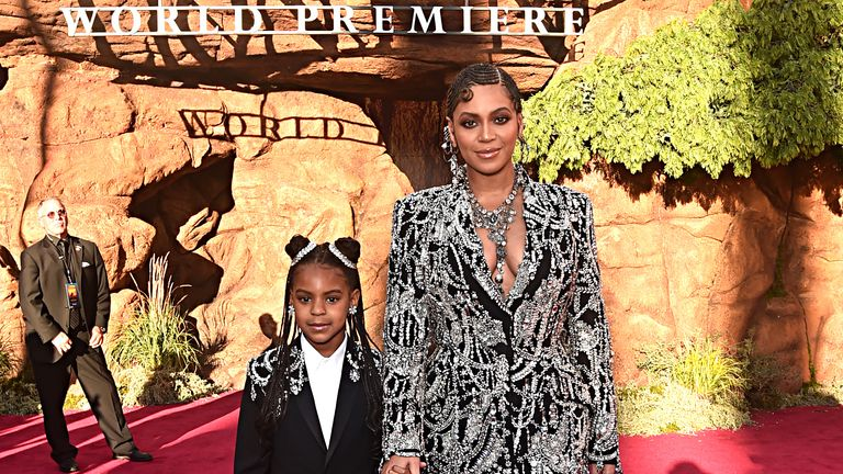 """HOLLYWOOD, CALIFORNIA - JULY 09: (EDITORS NOTE: Retransmission with alternate crop.) Blue Ivy Carter (L) and Beyonce Knowles-Carter attend the World Premiere of Disney's """"THE LION KING"""" at the Dolby Theatre on July 09, 2019 in Hollywood, California. (Photo by Alberto E. Rodriguez/Getty Images for Disney"""