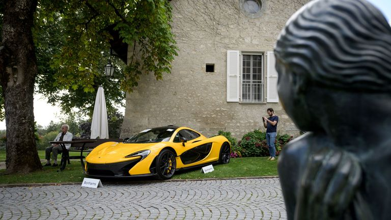 A picture taken on September 28, 2019 at the Bonmont Abbey in Cheserex, western Switzerland shows a McLaren P1 coupe model car during an auction preview by sales house Bonhams of sport cars belonging to the son of the Equatorial Guinea's President