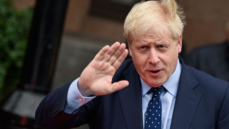 """Britain's Prime Minister Boris Johnson leaves The Midland hotel, near the Manchester Central convention complex in Manchester, northwest England on September 29, 2019, on the first day of the annual Conservative Party conference. - Embattled British Prime Minister Boris Johnson gathered his Conservative party Sunday for what could be its final conference before an election, promising to """"get Brexit done"""". (Photo by OLI SCARFF / AFP)"""