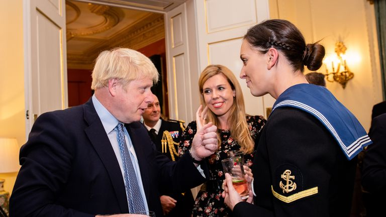 Boris Johnson, with his partner Carrie Symonds (middle) met with miliatry personnel at Downing Street