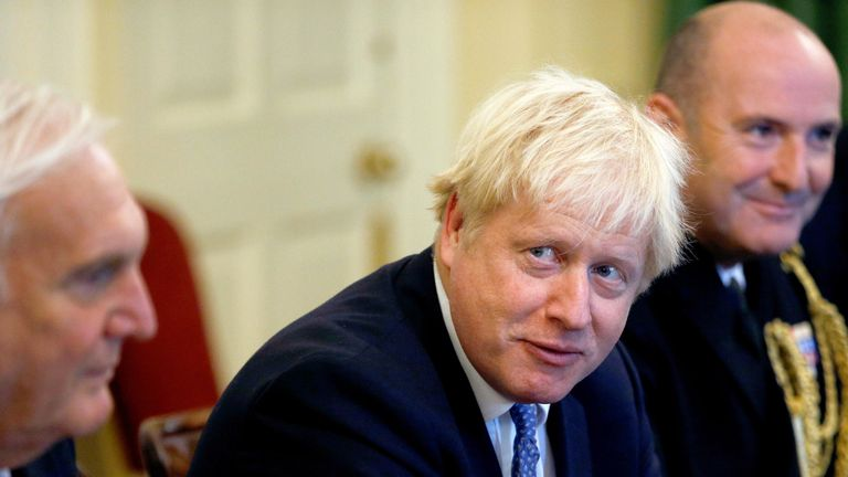Boris Johnson attends a roundtable at Downing Street