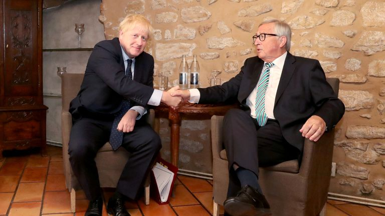 Boris Johnson shakes hands with European Commission President Jean-Claude Juncker
