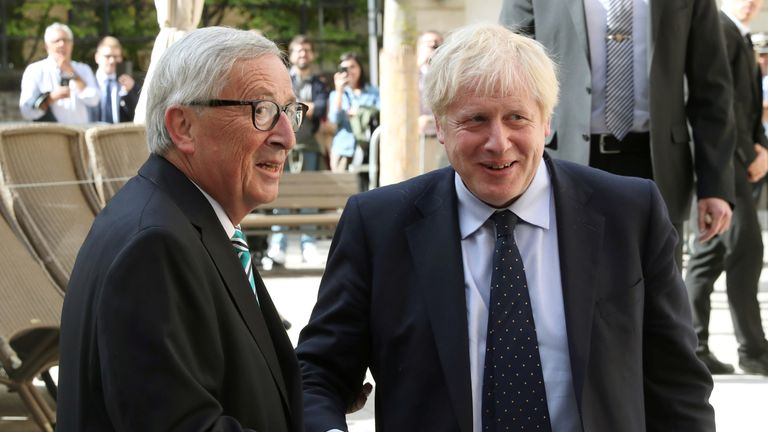 Boris Johnson shakes hands with European Commission President Jean-Claude Juncker during a meeting in in Luxembourg