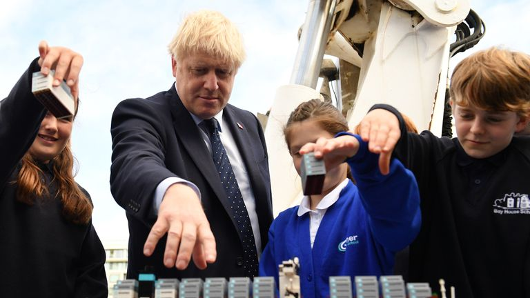 Prime Minister Boris Johnson takes part in an activity with school children as he visits the NLV Pharos