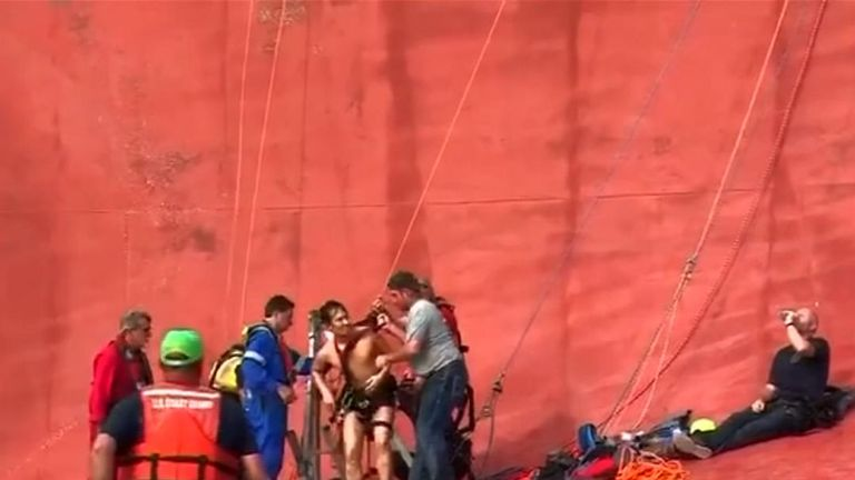 Crew member saved from capsized ship