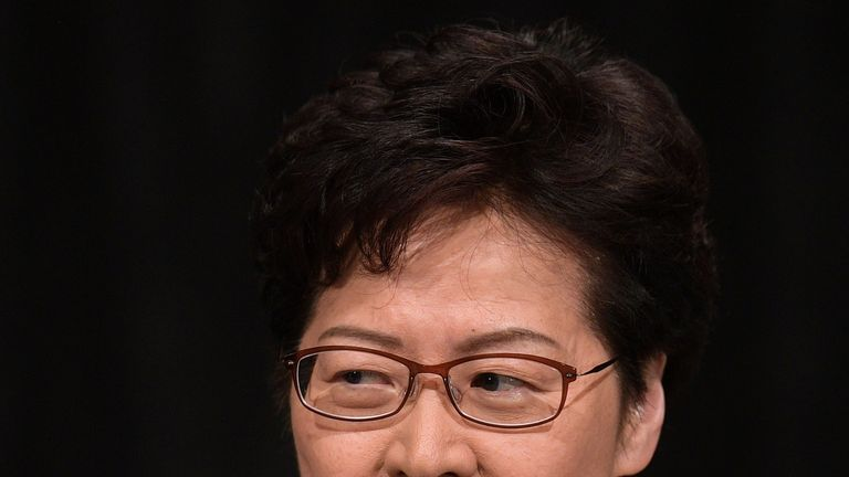 Carrie Lam speaks as she takes part in a town hall meeting at Queen Elizabeth Stadium