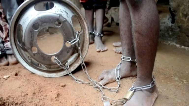 People with chained legs in Nigeria