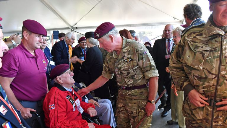 Prince Charles talks to former paratrooper Sandy Cortmann, 97, following his jump